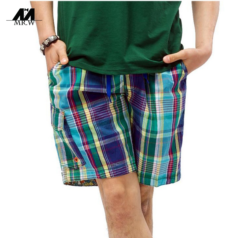 "Men's Shorts in Classic Plaid. He'll feel cool and look stylish in these Men's Plaid Shorts. This beloved summer style features front slash pockets and belt loops. The back pockets have a ""touch"" closure, perfect for keeping wallets and other essentials secure."