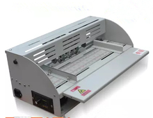 Book cover creasing machine, electric creasing machine, card folding machines, color pages dashed machine, speed can be adjusted(China (Mainland))