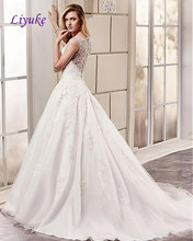 Buy Elegant Tulle V-Neck Neckline Natural Waistline A-Line Wedding Dress Court Train Beading Appliques Embroidery Bride Dress Liyuke for $208.23 in AliExpress store