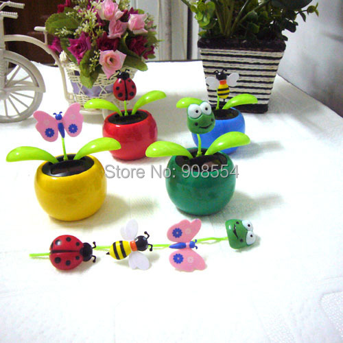 Wholesale 8 Pieces Per Lot Leaves Swing Ceaselessly Under Full Light Solar Dancing Flowers Car Decoration Novelty Energy Toys(China (Mainland))