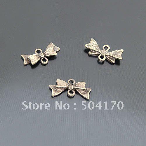 Здесь можно купить  500pcs/lot ZAKKA 20*8mm Bowknot Bronze Jewelry Spacers Antique Brass Earring Accessory Free Shipping CXY083  Ювелирные изделия и часы
