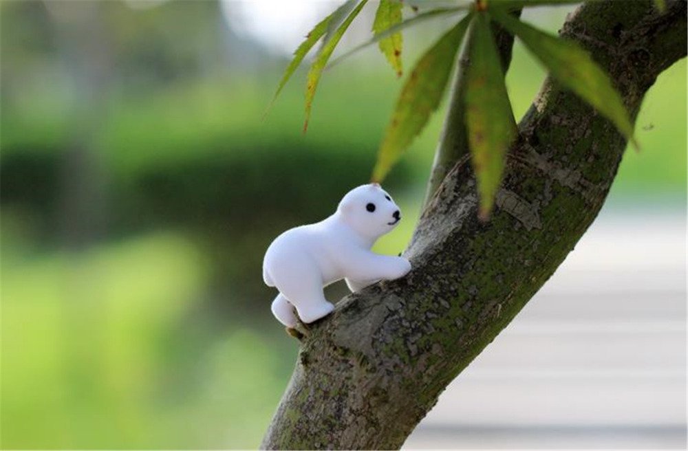 Free shipping kids toys for girls and boys white bear toys action anime figure brinquedo doll micro landscape new year gift(China (Mainland))