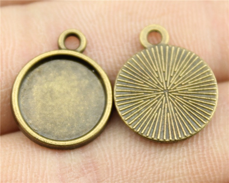 12pcs 12mm inner size (One Sided, Round Shape) Vintage Antique Bronze Plated Metal Zinc Alloy Cameo Cabochon Base Setting(China (Mainland))