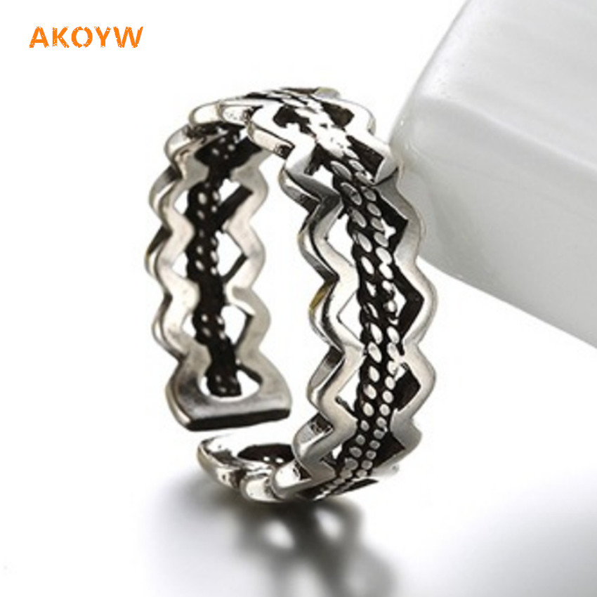 Geometrically symmetrical hollow Silver plated ring retro personality opening ring female models of high-end jewelry popular(China (Mainland))