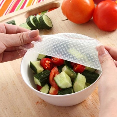 Food-Grade Patent Product Reused Silicone Cling Film Food Wrap Fresh Lid Saran Wrap & Plastic Bags HM387(China (Mainland))