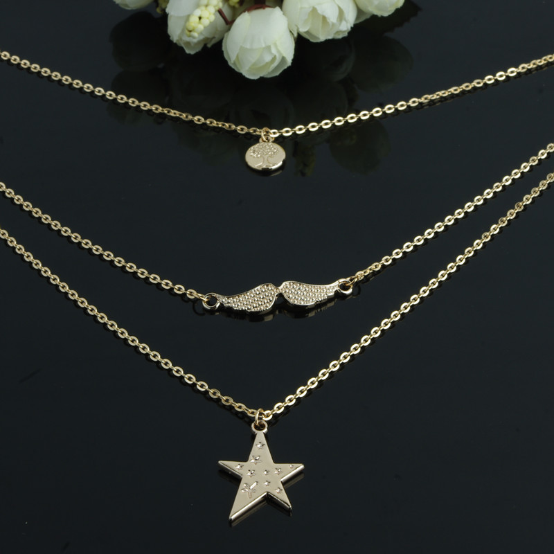 Simple multi element star angel wings trees multi layer gold ...