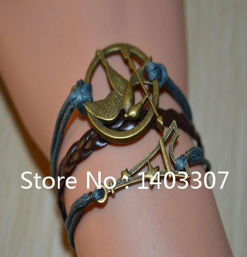 1Pcs Hot Sale Cute Hunger Game Bird Eiffel Tower With Star Shaped Braid Leather Bracelets Bangles Vintage Bracelets Women Girls(China (Mainland))