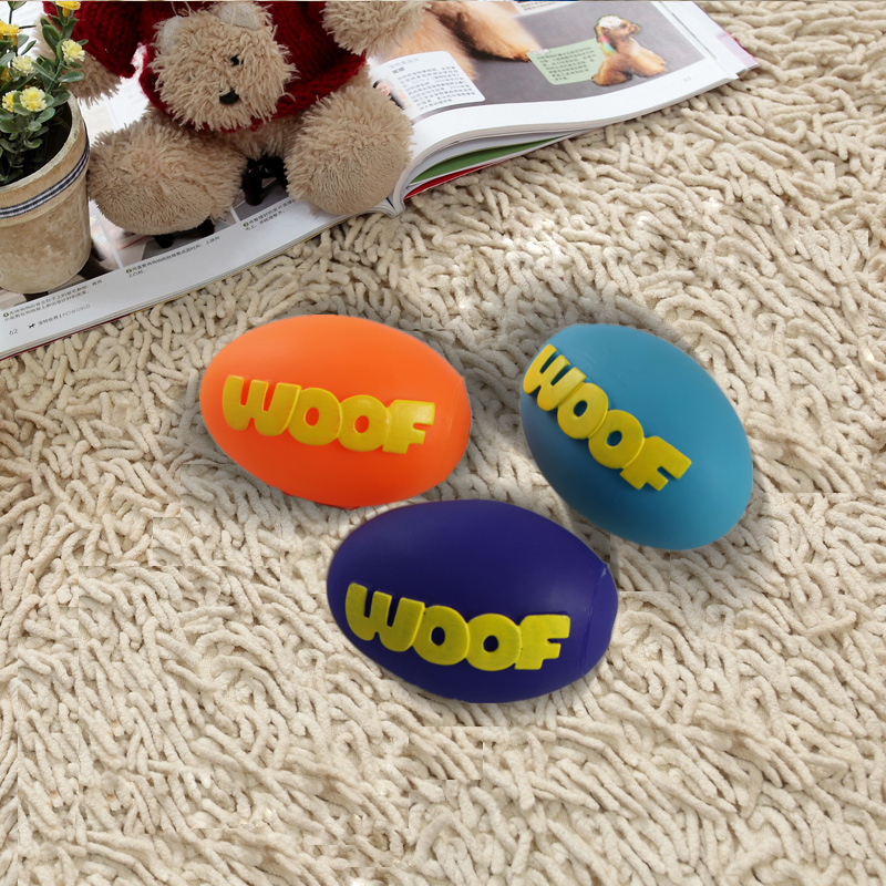 Free shipping WOOF Rugby Ball Pet Squeak Rubber Toy Dog Molars Good Quality Fun Bite And Chew Squeaker Ball Toy(China (Mainland))
