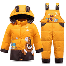 Dětská zimní oteplovací souprava ve žluté barvě – bunda a kalhoty s kšandy