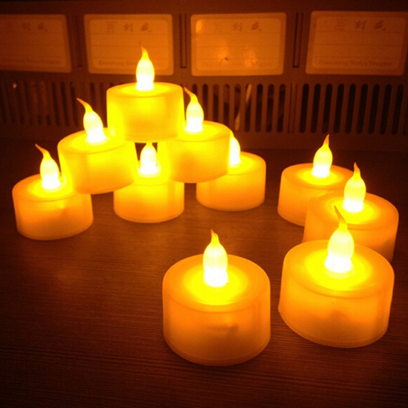 New 12 pcs/lot Flickering Flameless LED Tealight Flicker Tea Candle Light Xmas Party Wedding Candles Safety Home Decoration(China (Mainland))