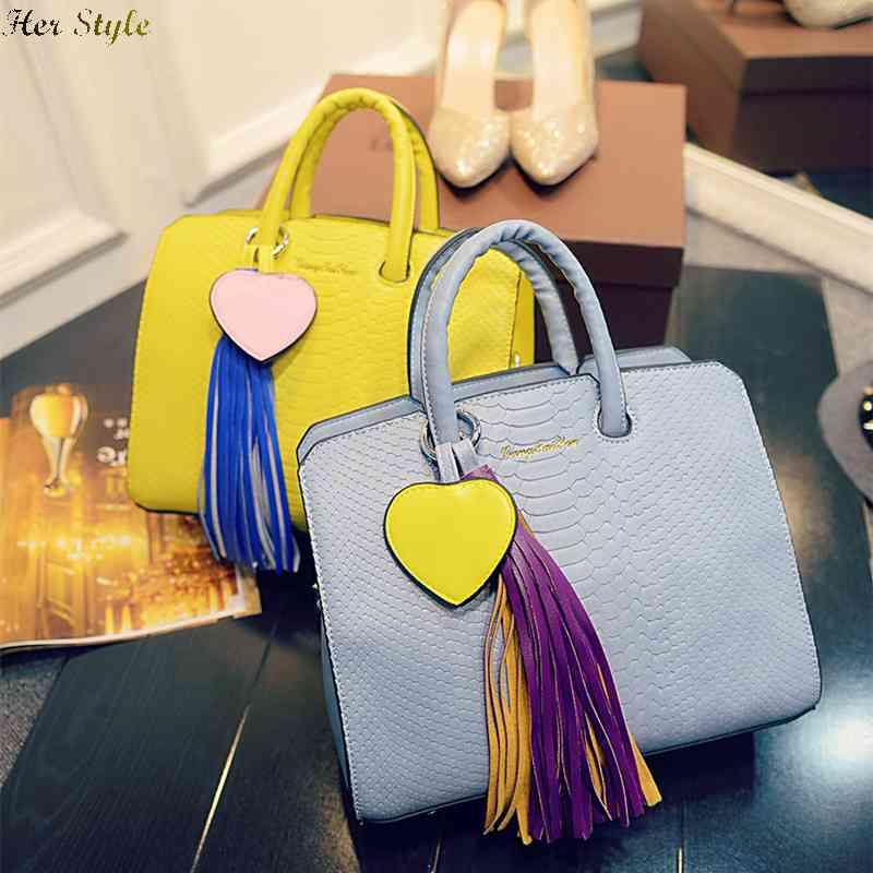 Free Shipping Sin City latest handbag fashion in Europe and America Dragon Marca tassel mobile 1432840671(China (Mainland))