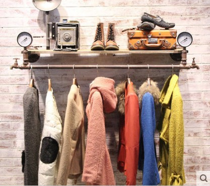 vintage clothing store display racks on old wood pipes do
