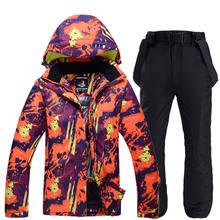Hombres y Mujeres ropa de montaña de nieve deportes al aire libre snowboard impermeable a prueba de viento traje de esquí de invierno conjuntos chaqueta y pantalón babero(China)